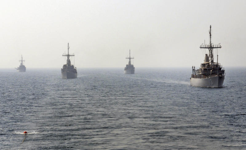 This handout photo released by the U.S. Navy, 5th Fleet taken on Wednesday, Aug. 29, 2012 shows USS Navy mine counter measure ships, from right to left, USS Dextrous , USS Sentry, USS Devastator and USS Pioneer get in line to conduct an astern replenishment-at-sea. The United States and more than two dozen allies are gearing up for the largest naval exercises ever in the Middle East focused on countering the threat of anti-ship mines (AP Photo/U.S. Navy,Toni Burton)