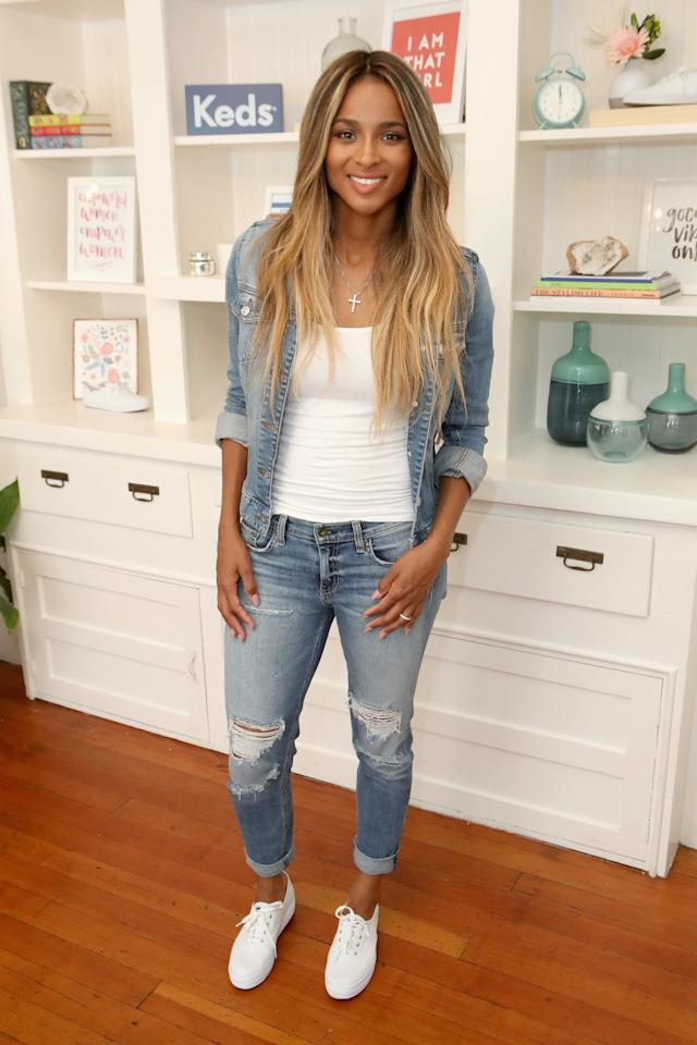 """<p>Denim and sneakers are a classic duo. <a rel=""""nofollow"""" href=""""http://www.self.com/topic/ciara?mbid=synd_yahooentertainment"""">Ciara</a> brightened up her blue look with a white T-shirt and a fresh pair of <a rel=""""nofollow"""" href=""""http://www.keds.com/en/champion-originals/044209485237.html?cid=SEM-G_Shopping_CHAMPION%20ORIGINALS&kpid=14492W-044209485237&mbid=synd_yahooentertainment"""">Keds</a>.</p>"""