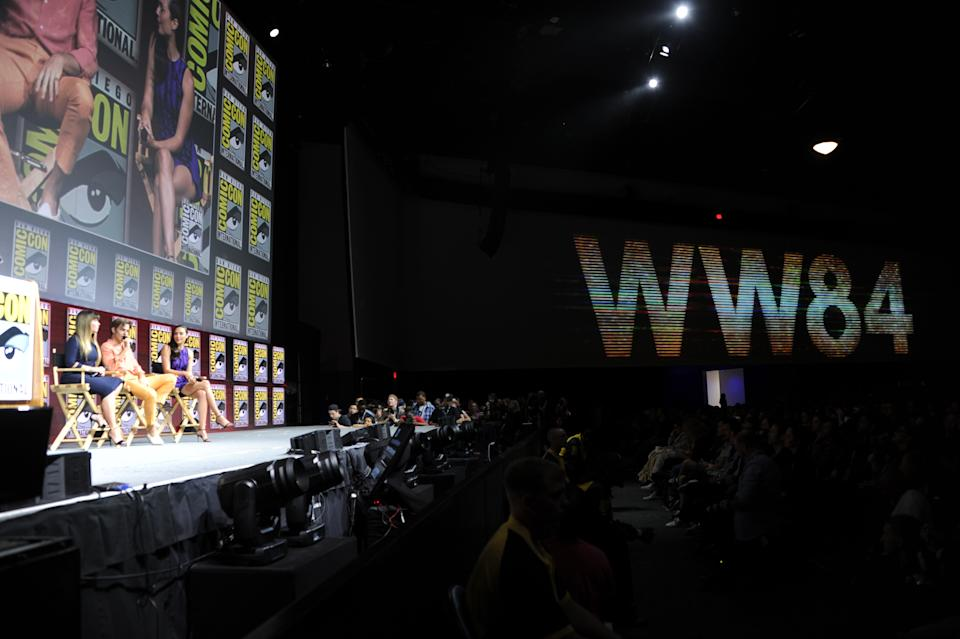 Patty Jenkins, Chris Pine and Gal Gadot speak onstage at the Warner Bros. 'Wonder Woman 1984' theatrical panel during Comic-Con International 2018 at San Diego Convention Center on July 21, 2018 in San Diego, California