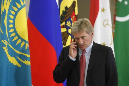 FILE PHOTO - Kremlin spokesman Dmitry Peskov speaks on the phone before a session of the Council of Heads of the Commonwealth of Independent States (CIS) in Sochi, Russia October 11, 2017. REUTERS/Maxim Shemetov