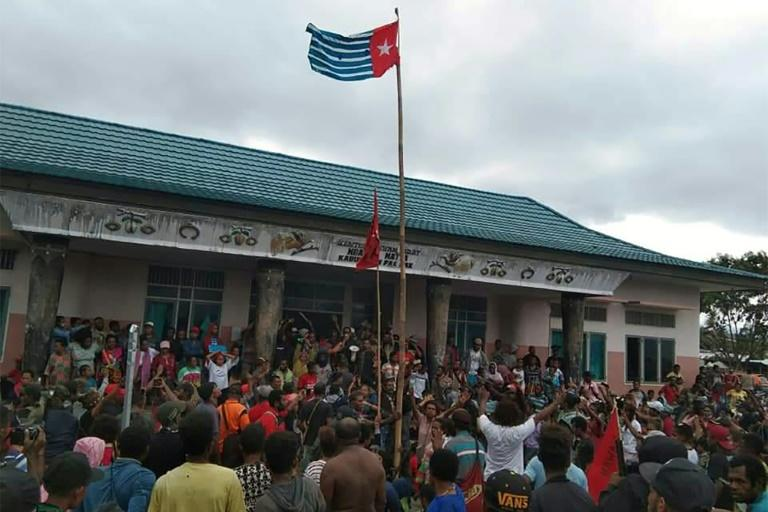 Protesters gather under the banned Papuan flag in the city of Fakfak