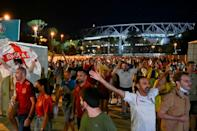 England fans celebrating on their way out of the Stadio Olimpico in Rome
