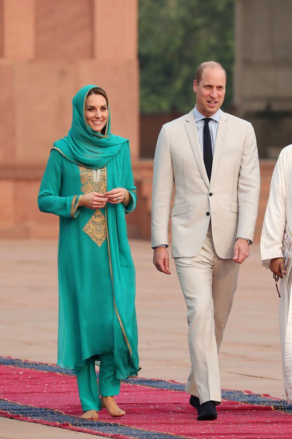 <p>The Duchess of Cambridge visits the Badshahi Mosque within the Walled City during day four of their royal tour of Pakistan. She wore a green and gold shalwar kameez. </p>
