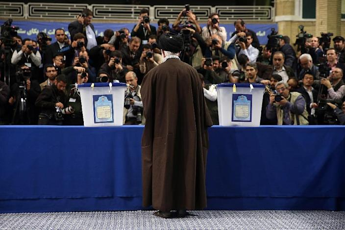 Iran's Supreme Leader Ayatollah Ali Khamenei casts his vote at a polling station in Tehran on February 26, 2016 (AFP Photo/)