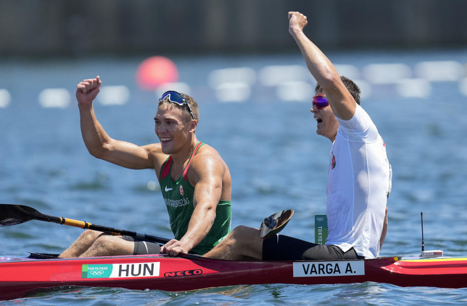 Balint Kopasz, left, and Adam Varga,, of Hungary react after finishing first and second respectively in the men's kayak single 1000m final at the 2020 Summer Olympics, Tuesday, Aug. 3, 2021, in Tokyo, Japan. (AP Photo/Lee Jin-man)