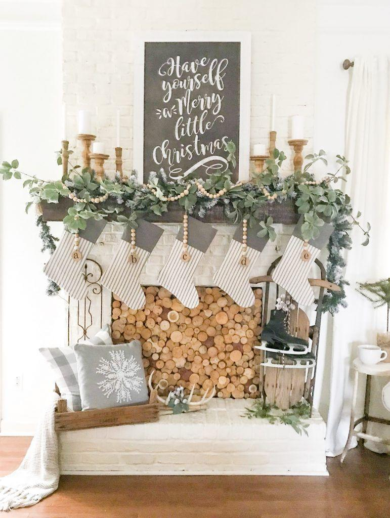 "<p>When your fireplace isn't in working order, fill it with wood circles for a really cool, rustic style. Additional wooden accents, like candle holders and beaded garland, tie the look together. </p><p><em>See more at <a href=""https://www.blessthisnestblog.com/wood-slice-fireplace-cover-diy-and-christmas-mantel/"" rel=""nofollow noopener"" target=""_blank"" data-ylk=""slk:Bless This Nest"" class=""link rapid-noclick-resp"">Bless This Nest</a>.</em></p><p><a class=""link rapid-noclick-resp"" href=""https://www.amazon.com/Garland-Christmas-Decorations-Farmhouse-Decoration/dp/B08JJ7VKWR?tag=syn-yahoo-20&ascsubtag=%5Bartid%7C10072.g.34484299%5Bsrc%7Cyahoo-us"" rel=""nofollow noopener"" target=""_blank"" data-ylk=""slk:SHOP BEADED GARLAND"">SHOP BEADED GARLAND</a></p>"