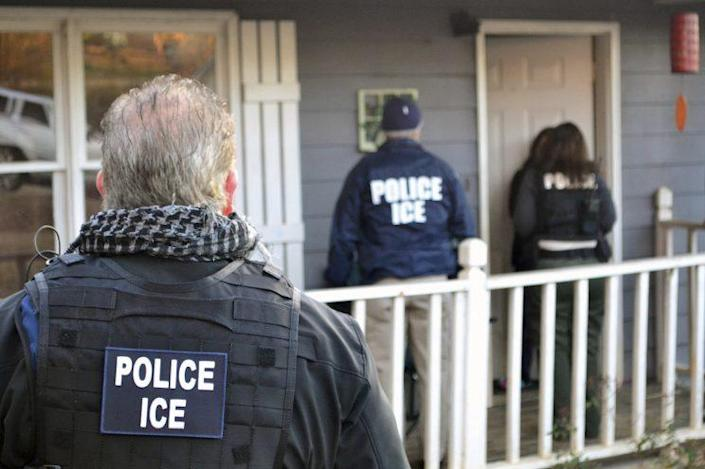 U.S. Immigration and Customs Enforcement provided this photo of ICE agents waiting at a home in Atlanta on Feb. 9, 2017, during a crackdown on immigration fugitives, re-entrants and criminal aliens. The Homeland Security Department said Feb. 13 that 680 people had been arrested in roundups in the previous week targeting immigrants living illegally in the United States. (Photo: Bryan Cox/ICE via AP)