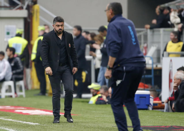 AC Milan coach Gennaro Gattuso, left, walks the pitch during the Serie A soccer match between AC Milan and Napoli at the San Siro stadium in Milan, Italy, Sunday, April 15, 2018. (AP Photo/Antonio Calanni)