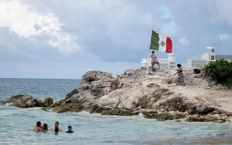 People spend time on the coast of Cancun, Mexico, Saturday, June 13, 2020 - Victor Ruiz/AP