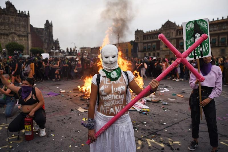 A woman poses for a photo while taking part in a protest during the International Women's Day, in Mexico City, on March 8, 2020. Source: Getty
