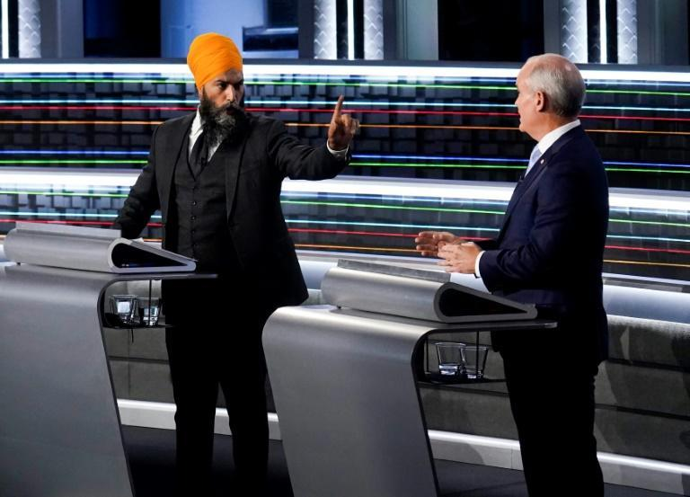 Rookie Canadian Conservative leader Erin O'Toole, who finds himself in a virtual tie with the incumbent Liberals, spars with fourth-ranked leftist New Democratic Party leader Jagmeet Singh at a debate (AFP/Adrian Wyld)
