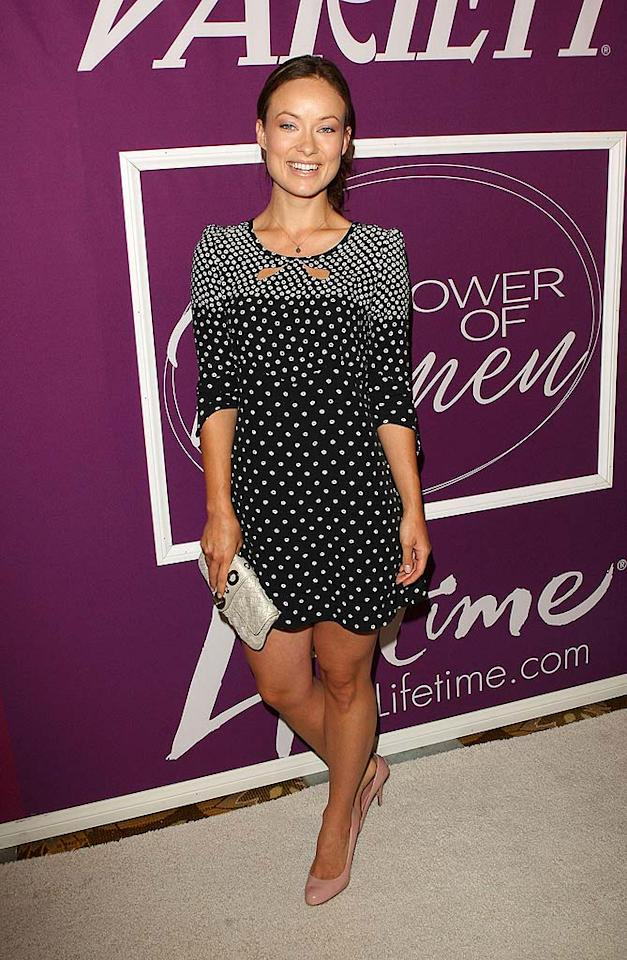 """The lovely Olivia Wilde worked a patterned dress, pinks pumps, and her signature smile. Jason Merritt/<a href=""""http://www.gettyimages.com/"""" target=""""new"""">GettyImages.com</a> - September 24, 2009"""
