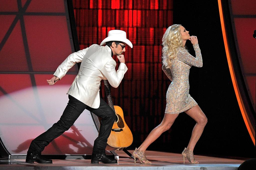 NASHVILLE, TN - NOVEMBER 01:  Brad Paisley and Carrie Underwood host the 46th annual CMA awards at the Bridgestone Arena on November 1, 2012 in Nashville, Tennessee.  (Photo by Frederick Breedon/FilmMagic)