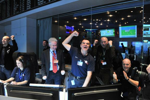 Rosetta mission scientists cheer as the comet-chasing probe's first signal after awaking from a 2.5-year sleep is received at the European Space Agency's Space Operations Center in Darmstadt, Germany on Jan. 20, 2014.