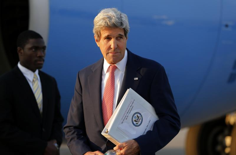 U.S. Secretary of Kerry leaves his plane at Vienna International Airport