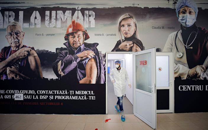 A vaccine distribution centre in Romania. The rollout in the EU has been hit by production delays - AP