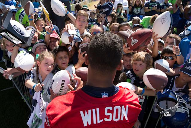 Russell Wilson remains the fan favorite in Seattle. He's scheduled to earn $17 million in the final season of his current contract. (AP)