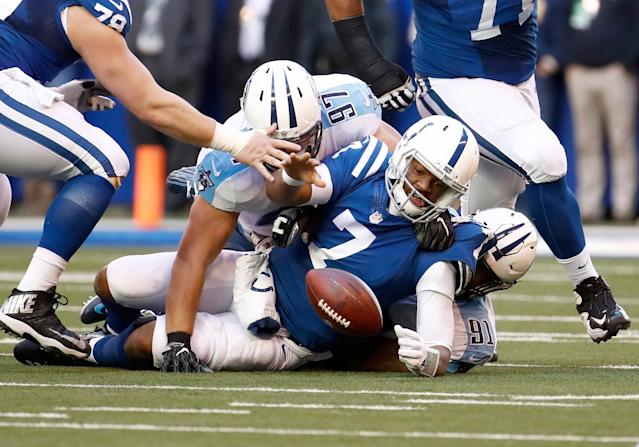 <p>Jacoby Brissett #7 of the Indianapolis Colts fumbles the ball against the Tennessee Titans at Lucas Oil Stadium on November 26, 2017 in Indianapolis, Indiana. (Photo by Andy Lyons/Getty Images) </p>