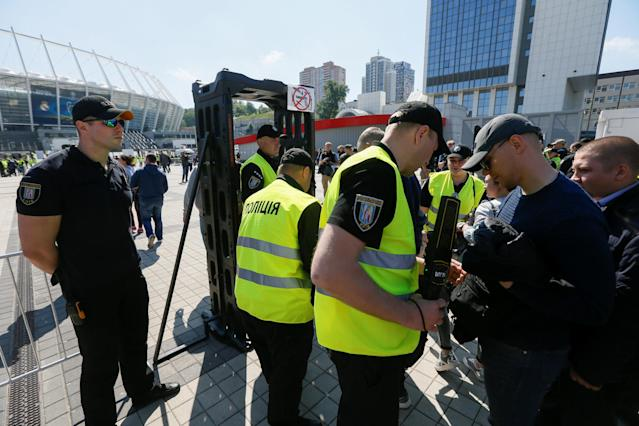 Members of the Ukrainian National Police and volunteers take part in a security exercise during preparations for the Champions League final between Real Madrid and Liverpool outside the NSC Olympic stadium in Kiev, Ukraine May 15, 2018. REUTERS/Valentyn Ogirenko