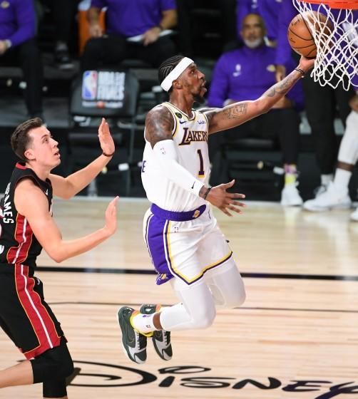 ORLANDO, FLORIDA OCTOBER 11, 2020-Lakers Kentavious Caldwell-Pope beats Heats Duncan Robinson.