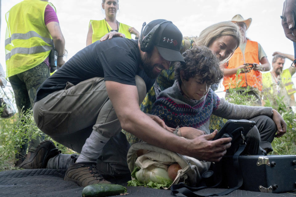"""This image released by Paramount Pictures shows director John Krasinski, left, with Noah Jupe and Emily Blunt on the set of """"A Quiet Place Part II."""" (Jonny Cournoyer/Paramount Pictures via AP)"""