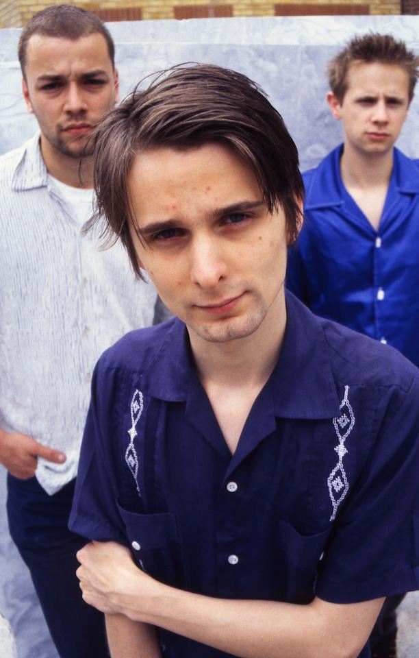 LONDON - JUNE 1999:  Matthew Bellamy (C), Dominic Howard (R) and Christopher Wolstenholme (L) of British rock group Muse pose, circa June 1999 as they promote their debut album 'Showbiz', in West London England. (Photo by Jim Dyson/Getty Images)