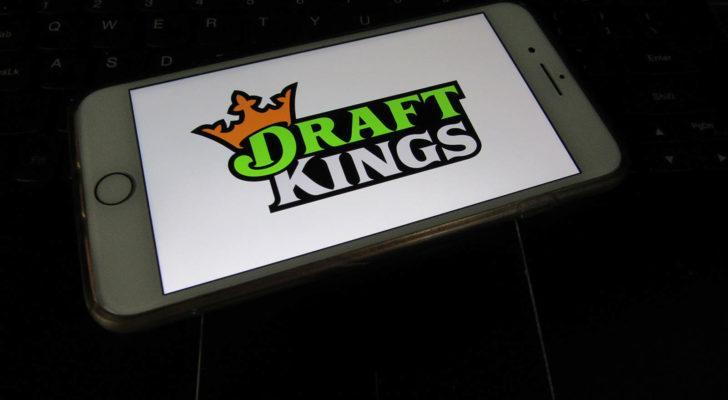 DraftKings (DKNG) logo on a phone