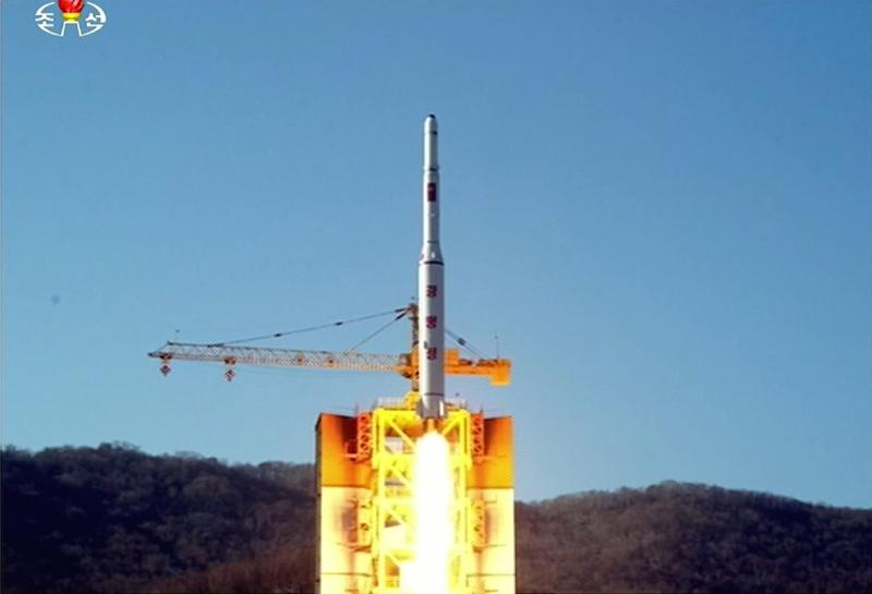This picture taken from North Korean TV and released by South Korean news agency Yonhap on February 7, 2016 shows North Korea's locket launch of earth observation satellite Kwangmyong 4 (AFP Photo/Yonhap)