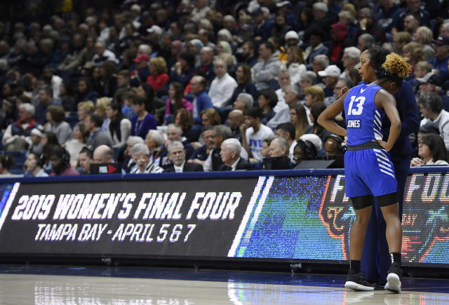 Buffalo's Autumn Jones (13) listens as Buffalo head coach Felisha Legette-Jack talks to her during the first half of a second-round women's college basketball game against Connecticut in the NCAA tournament, Sunday, March 24, 2019, in Storrs, Conn. (AP Photo/Jessica Hill)