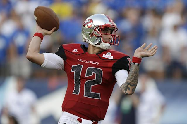 Western Kentucky quarterback Brandon Doughty passes against Kentucky in the first quarter of an NCAA college football game on Saturday, Aug. 31, 2013, in Nashville, Tenn. (AP Photo/Mark Humphrey)