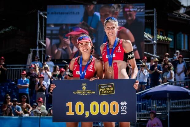 Melissa Humana-Paredes, left, and Sarah Pavan pose after winning the bronze-medal match at the FIVB World Tour event in Gstaad, Switzerland, on Sunday. (FIVB - image credit)