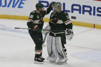 Minnesota Wild's Ian Cole (28) celebrates with goalie Kaapo Kahkonen (34) after their win over the Vegas Golden Knights in an NHL hockey game Monday, March 8, 2021, in St. Paul, Minn. (AP Photo/Stacy Bengs)
