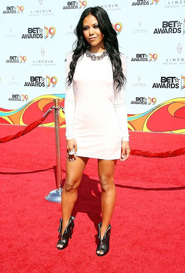 "Amerie was a vision in her white mini. The RnB singer completed her ensemble with metallic peep-toe booties, featuring fun skull zippers. Maury Phillips/<a href=""http://www.wireimage.com"" target=""new"">WireImage.com</a> - June 28, 2009"
