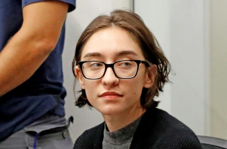 US student Lara Alqasem, who appealed after she was refused entry to Israel over her alleged support for a pro-Palestinian boycott campaign, sits in a Tel Aviv district Court on October 11, 2018