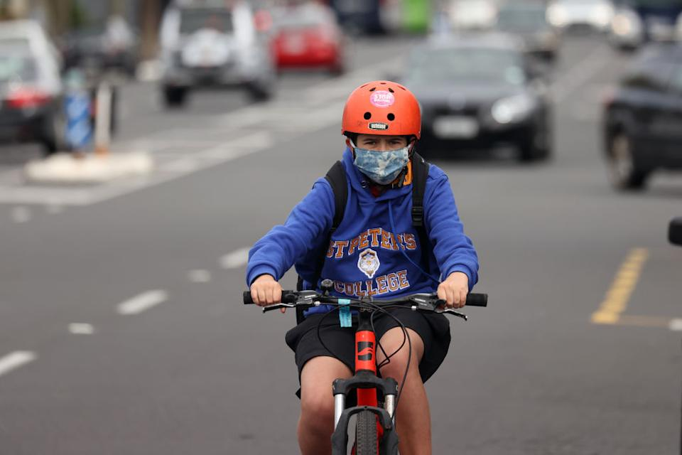 A boy rides his bike along Ponsonby Road in Auckland, New Zealand.