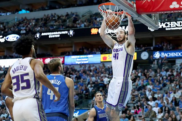 DALLAS, TEXAS - MARCH 26: Kosta Koufos #41 of the Sacramento Kings dunks the against Dirk Nowitzki #41 of the Dallas Mavericks in the first half at American Airlines Center on March 26, 2019 in Dallas, Texas. (Photo by Tom Pennington/Getty Images)