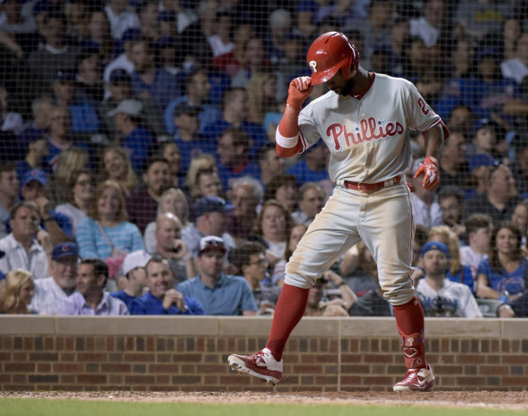 Philadelphia Phillies' Andrew McCutchen (22) scores on his home run against the Chicago Cubs during the eighth inning of a baseball game Wednesday, May 22, 2019, in Chicago. (AP Photo/Mark Black)