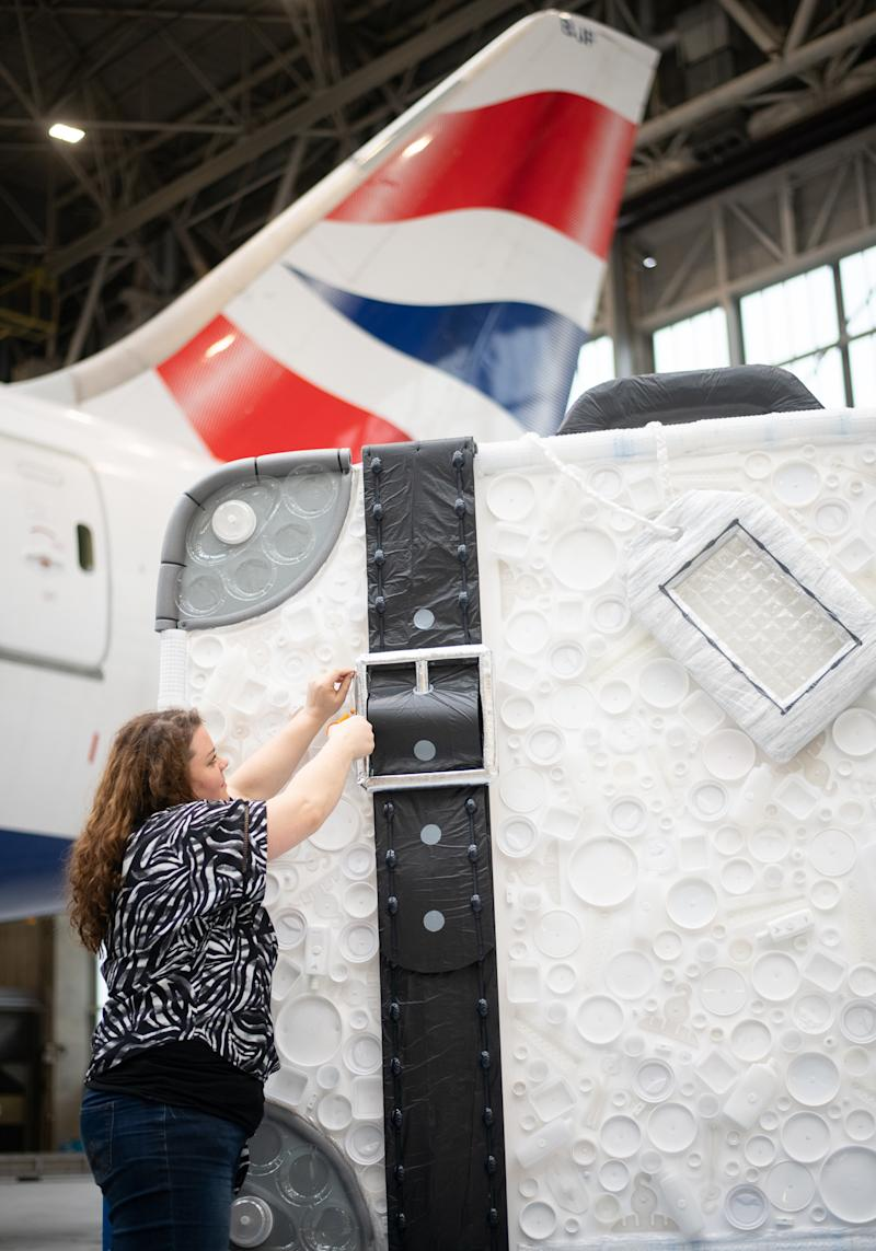 Eco-artist Sarah Turner adds the finishing touches to her creation (British Airways/PA)