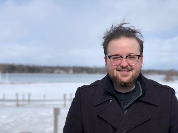 Ash Arsenault is one of the clinic volunteers. He is a law student at the University of New Brunswick and is from Prince Edward Island. (Nicola MacLeod/CBC - image credit)