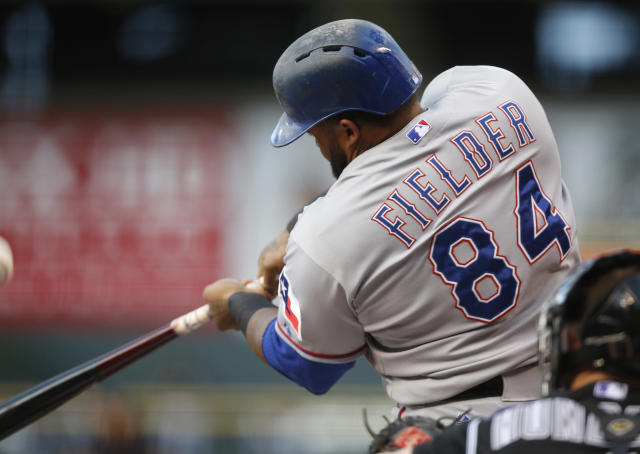 Texas Rangers Prince Fielder fouls off a pitch on the way to earning a walk against the Colorado Rockies in the first inning of an inter league baseball game Tuesday, July 21, 2015, in Denver. (AP Photo/David Zalubowski)
