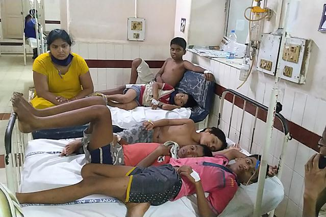 EDITORS NOTE: Graphic content / Children affected by a gas leak from an LG Polymers plant lay on beds at the King George hospital in Visakhapatnam on May 7, 2020. - At least five people have been killed and 1,000 hospitalised after a gas leak at a chemicals plant on the east coast of India, authorities said on May 7, warning the death toll would climb. The gas leaked out of two 5,000-tonne tanks that had been unattended due to India's coronavirus lockdown in place since late March, according to a local police officer. (Photo by - / AFP) (Photo by -/AFP via Getty Images)