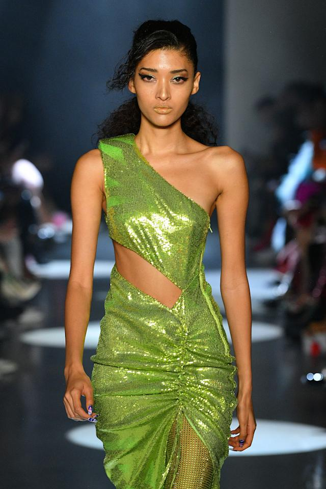 """<p><a href=""""https://www.instagram.com/laurentphilippon/?hl=en"""">Laurent Philippon</a> was inspired by Jamie Lee Curtis' signature look in 1994's <em>True Lies </em>for Christian Cowan's fall/winter 2020 runway. He used <a href=""""https://click.linksynergy.com/deeplink?id=93xLBvPhAeE&mid=2417&murl=https%3A%2F%2Fwww.sephora.com%2Fproduct%2Fspray-de-mode-flexible-hold-hairspray-P280512&u1=IS%2CNYFWPonytails%253AChristianCowan%2C%2C%2CIMA%2C3523318%2C202002%2CI"""" target=""""_blank"""">Bumble and bumble's Spray de Mode Flexible Hold Hairspray</a> on textured hair to create piecey, side-parted ponytails. </p>"""