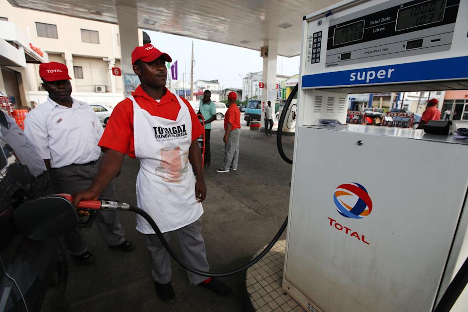 <p> A petrol attendant fills a car at a Total petrol station in Lagos, Nigeria, Monday, Nov. 19, 2012. French oil company Total SA said Monday it had sold its stake in an offshore oil field near Nigeria for $2.5 billion to the Chinese state-run firm Sinopec Corp., a sign of the China's growing stakes in the West African nation's oil production. (AP Photo/Sunday Alamba) </p>