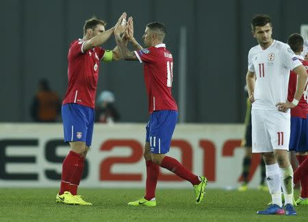 Football Soccer - Georgia v Serbia - World Cup 2018 Qualifiers - Group D - Boris Paichadze Dinamo Arena,Tbilisi, Georgia - 24/3/17. Serbia's Branislav Ivanovic and Aleksandar Kolarov celebrate after winning their match. REUTERS/David Mdzinarishvili