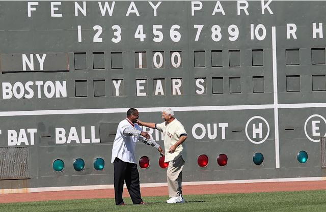 BOSTON, MA - APRIL 20: Carl Yazstremski and Jim Rice, former Boston Red Sox players, shake hands during 100 Years of Fenway Park activities before a game between the Boston Red Sox and the New York Yankees at Fenway Park April 20, 2012 in Boston, Massachusetts. (Photo by Jim Rogash/Getty Images)
