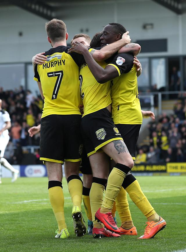 "Soccer Football - Championship - Burton Albion vs Derby County - Pirelli Stadium, Burton-on-Trent, Britain - April 14, 2018 Burton Albion's Lucas Akins celebrates with team mates after scoring their third goal Action Images/John Clifton EDITORIAL USE ONLY. No use with unauthorized audio, video, data, fixture lists, club/league logos or ""live"" services. Online in-match use limited to 75 images, no video emulation. No use in betting, games or single club/league/player publications. Please contact your account representative for further details."