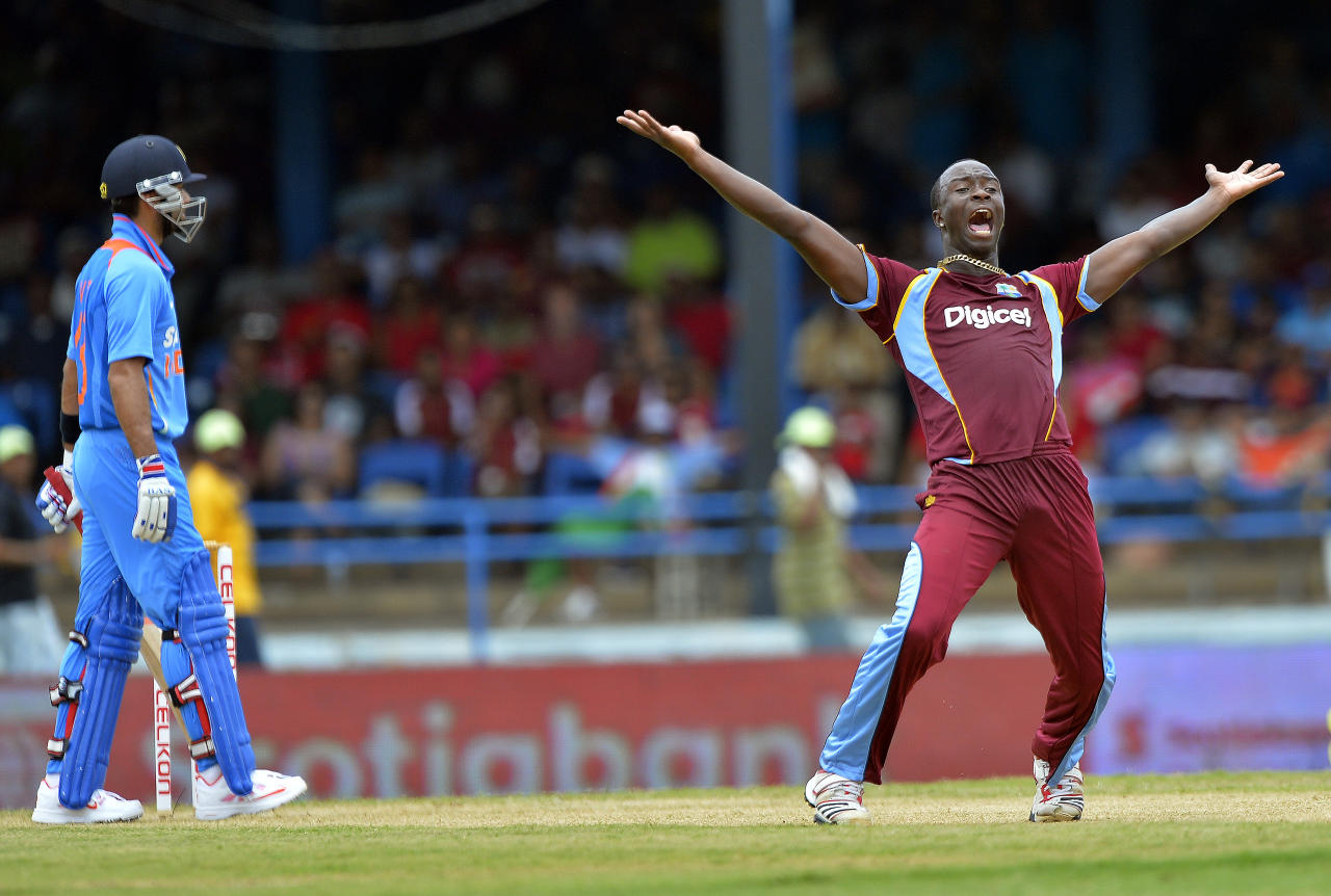 West Indies cricketer Kemar Roach (R) unsuccessfully appeals for a dismissal against Indian cricket team captain Virat Kohli during the fourth match of the Tri-Nation series between India and West Indies at the Queen's Park Oval in Port of Spain on July 5, 2013. West Indies won the toss and elected to field. AFP PHOTO/Jewel Samad        (Photo credit should read JEWEL SAMAD/AFP/Getty Images)