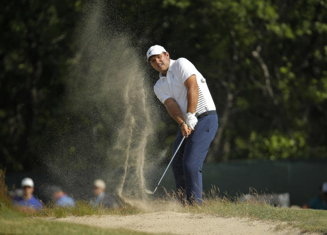 Patrick Reed plays a shot from a bunker on the 12th hole during the final round of the U.S. Open Golf Championship, Sunday, June 17, 2018, in Southampton, N.Y. (AP Photo/Carolyn Kaster)