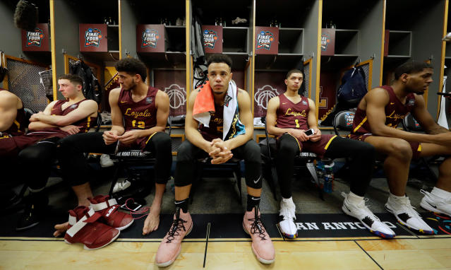 Loyola-Chicago's Marques Townes (5) and the rest of the team react in the locker room after the semifinal game against Michigan in the Final Four NCAA college basketball tournament, Saturday, March 31, 2018, in San Antonio. Michigan won 69-57. (AP Photo/Eric Gay)