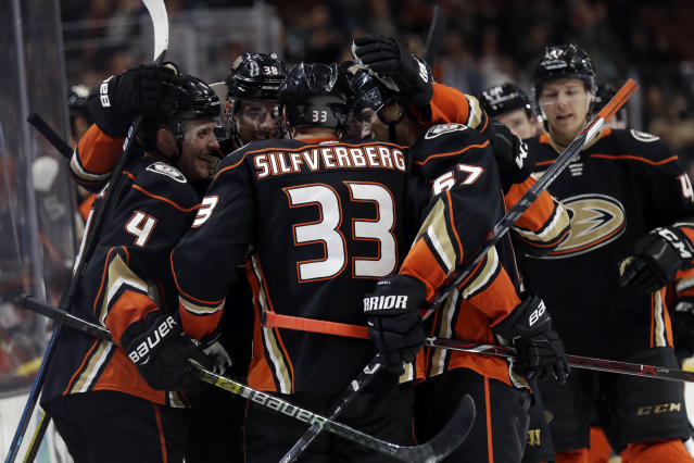 Anaheim Ducks' Jakob Silfverberg (33) is mobbed by teammates after scoring the game-winning goal in overtime in an NHL hockey game against the San Jose Sharks Friday, March 22, 2019, in Anaheim, Calif. Anaheim won 4-3. (AP Photo/Marcio Jose Sanchez)